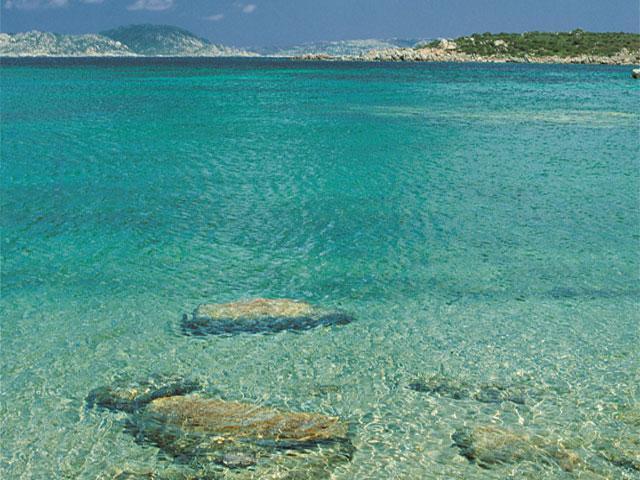 Hotel La Coluccia ligt direkt aan het strand van Conca Verde - Sardinie