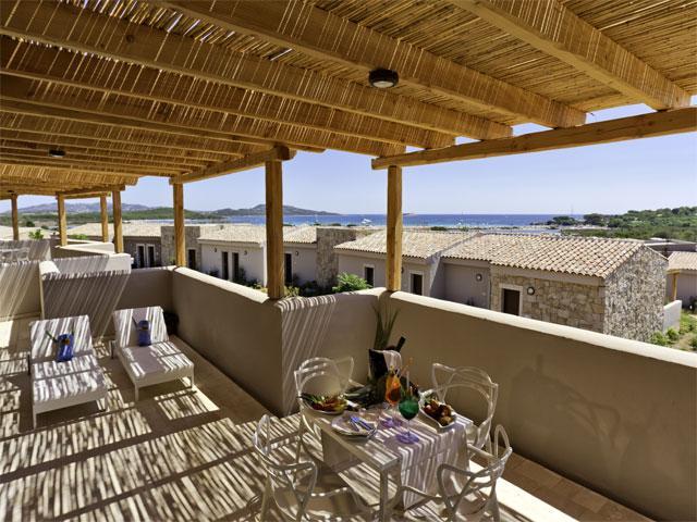 Een hotelkamer met zeezicht terras - Paradise Resort in Sardinie